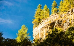 Autumn mountain forest cliff view. Mountain forest rock cliff in autumn. Autumn mountain cliff. Autumn mountain forest cliff