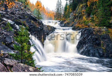 Autumn mountain forest waterfall river in Karelia, Russia #747085039