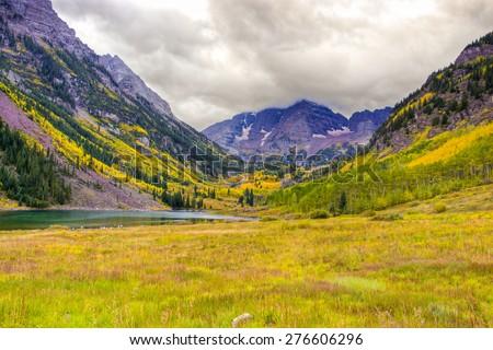 Autumn mountain  landscape on a cloudy day. Colorado, USA #276606296