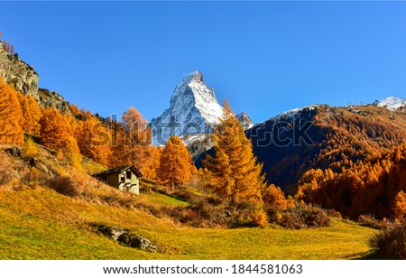 Autumn mountain peak snow landscape. Mountain cabin in autumn mountains. Mountain peak snow in autumn mountains. Autumn mountains landscape