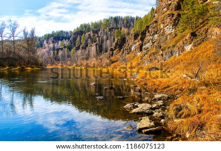 Autumn mountain river landscape. Mountain river autumn scene. Autumn mountain river shore view. Autumn mountain river water