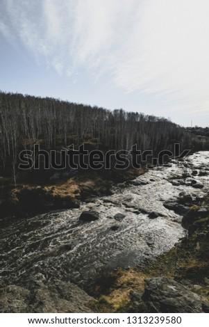 Autumn mountain river stream landscape. Mountain river autumn view. Autumn mountain river panorama.