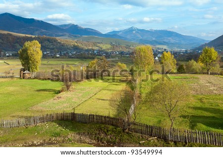 Autumn mountain village with stack of hay (Kolochava, Carpathian Mt's, Ukraine).