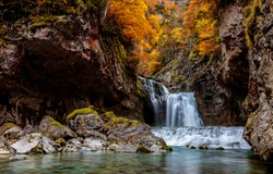 Autumn mountain waterfall stream view. Waterfall in autumn mountains. Autumn waterfall in mountains. Autumn mountain waterfall landscape