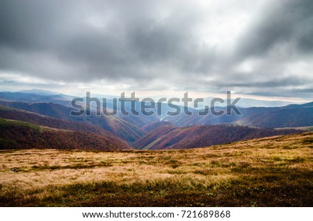 Autumn mountains in cloudly day #721689868
