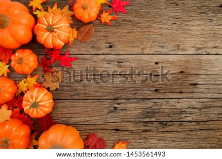 Autumn multicolored  leaves and pumpkins old brown wood table background with copy space, flat lay, minimal concept