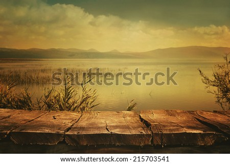 Autumn nature background. Table with Lake and cloudscape art Design. Autumn landscape