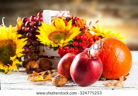 Autumn nature concept. Fall fruit and vegetables on wooden table #324775253