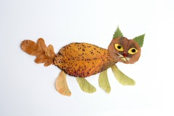 autumn nature craft for kids, cat made of leaf, top view, activity for children