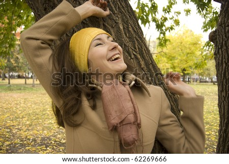 Autumn nature. Portrait of young attractive woman outdoor at park
