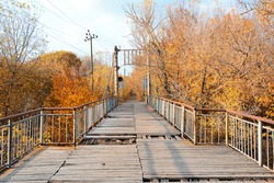 Autumn - Old wooden bridge in the autumn park on a sunny day. Horizontal