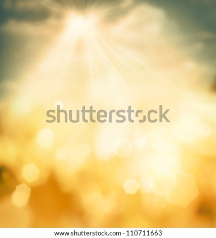 Autumn or summer abstract nature background with grass in the meadow and blue sky in the back