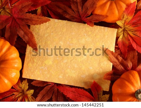Autumn or thanksgiving greeting card with copy space. (artificial leaves)