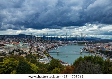Autumn panoramic view from Gellert Hill to Buda Castle and King Palace Budavari Palota of the Hungarian kings and river Danube with Szechenyi Chain Bridge on stormy weather Stock fotó ©