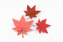 Autumn paper origami maple leaf on white background