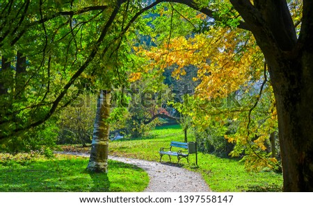 Autumn park bench landscape view. Park bench in autumn park. Autumn park bench landscape. Autumn park bench scene #1397558147