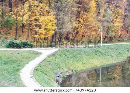 Autumn park trail landscape - Shutterstock ID 740974120
