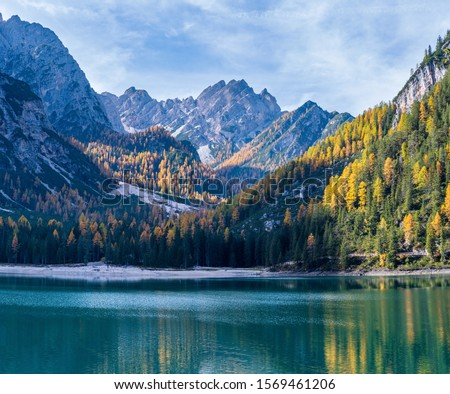 Autumn peaceful alpine lake Braies or Pragser Wildsee. Fanes-Sennes-Prags national park, South Tyrol, Dolomites Alps, Italy, Europe. People are unrecognizable. #1569461206