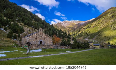 Autumn picture of Vall de Nuria - sanctuary and ski resort in Catalan Pyrenees - on sunny day, blue sky with single white clouds Foto stock ©
