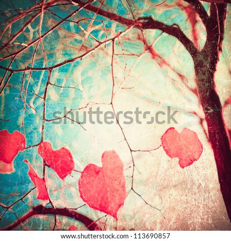 Autumn, pink leafs on vintage textured blue sky