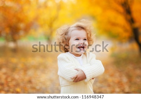 Autumn portrait of cute curly girl