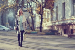 Autumn portrait of happy girl on a walk