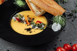 Autumn pumpkin cream soup with dor blue.