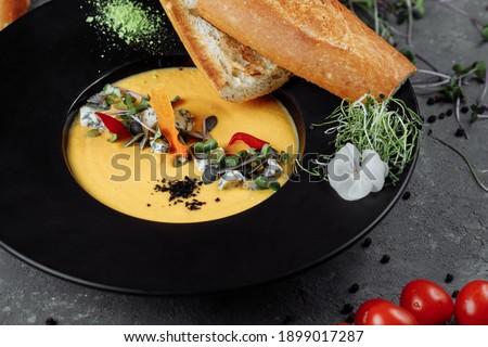 Autumn pumpkin cream soup with dor blue. Stockfoto ©