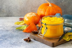 Autumn pumpkin meals for thanksgiving day. Pumpkin Puree on a slate background. Copy space.