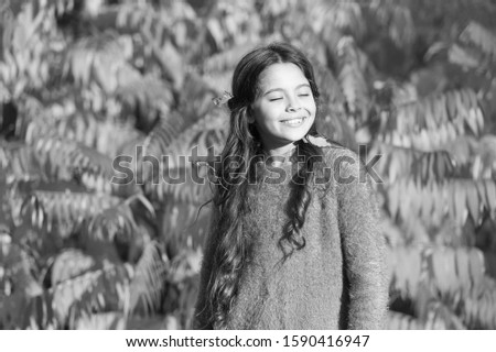 Autumn puts her in good mood. Happy small girl in autumn mood outdoors. Little child play on fresh air on autumn day. Setting fall mood. Good mood good day.