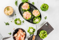 Autumn recipes. Home stuffed bell pepper with minced meat, carrots, tomatoes, herbs and cheese. Cooking process. On a white marble table. Top view. Copy space