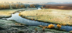Autumn river. A misty morning near a picturesque river