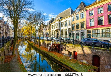Autumn river dutch city landscape. Stree canal in autumn day in Netherlands. Autumn in city scene