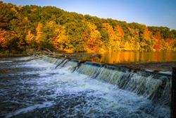 Autumn River Landscape. Gorgeous forest landscape with peak fall colors and a small waterfall at Fitzgerald County Park in Eaton County, Michigan.