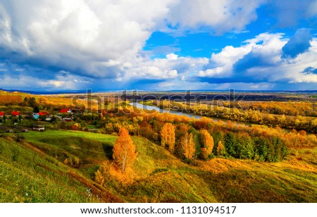 Autumn river valley village panoramic landscape. Golden autumn river valley panorama. Autumn river forest village view