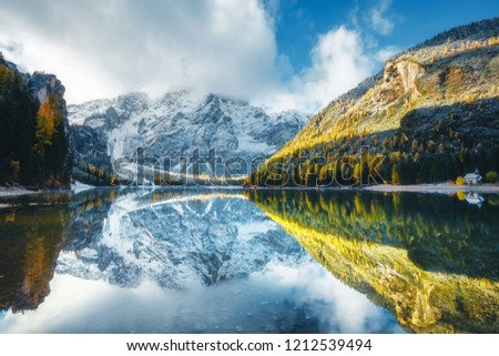 Autumn scenery of peaceful alpine lake Braies (Pragser Wildsee). Location Dolomiti Alps, national park Fanes-Sennes-Braies, Italy, Europe. Scenic image of Italian Alps. Discover the beauty of earth. #1212539494