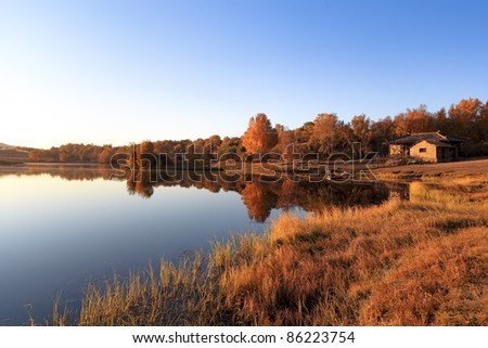 autumn scenery of the tranquil lake in morning