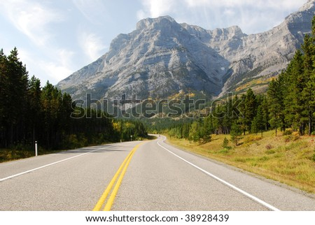 Autumn scenic view of rocky mountains and highway 40 while traveling in kananaskis country, alberta, canada
