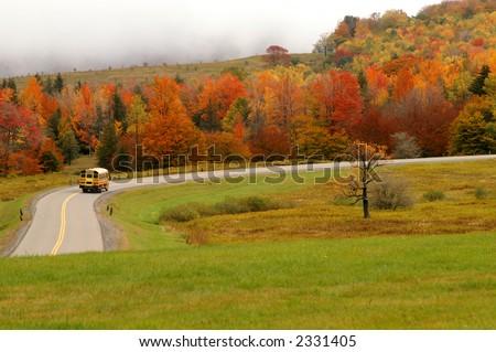 Autumn School Bus on Mountain Road