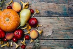 Autumn seasonal vegetables and fruits (pumpkin, pear, apples, corn, chanterelles). Autumn products from the farm, or garden. Vegan eco concept. Copy space.