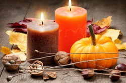 Autumn setting with candles and pumpkin