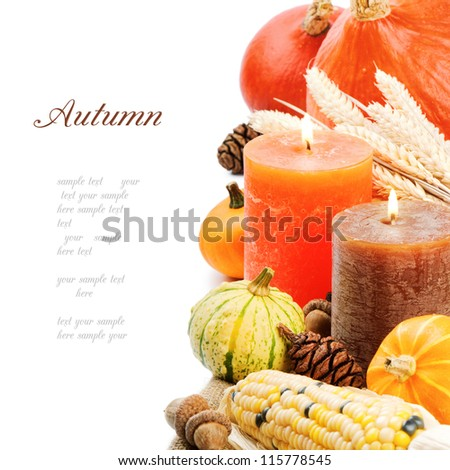 Autumn setting with candles and pumpkins isolated on white