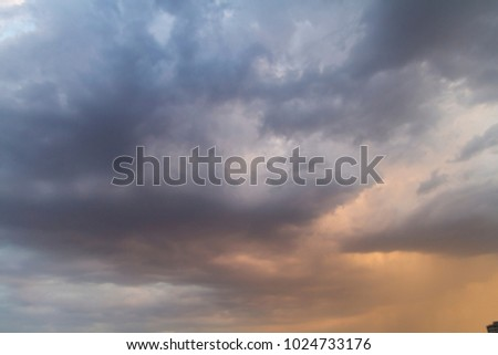 Autumn sky with dark colors and very gray clouds and rain-laden