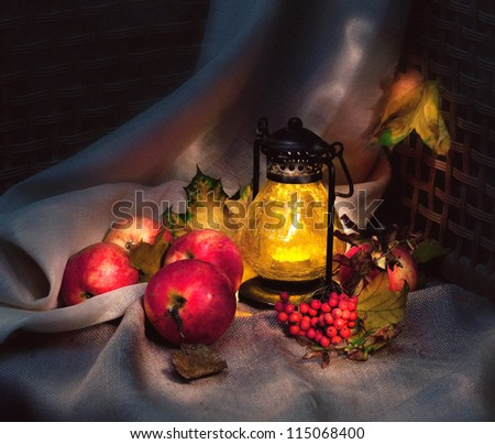 Autumn still life with apples and lamp, light painting