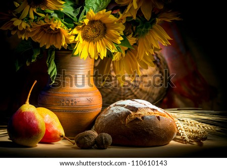 autumn still life with bread and sunflower