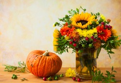 Autumn still life with flowers and pumpkin