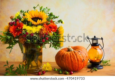 Autumn still life with flowers and pumpkin #470419733