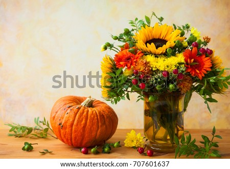 Autumn still life with flowers and pumpkin #707601637
