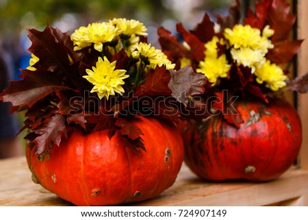 Autumn still life with flowers and pumpkin #724907149