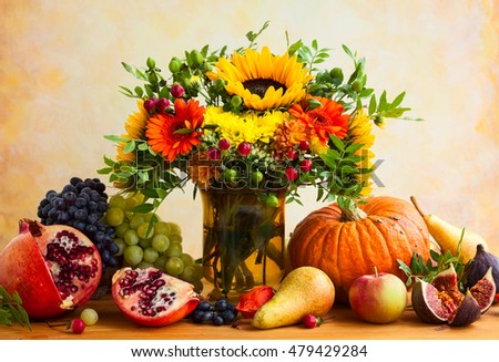 Autumn still life with flowers, pumpkin and fruits #479429284